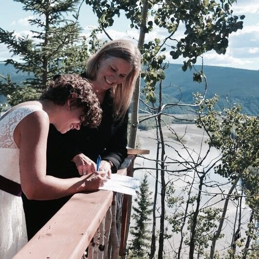 Signing the paperwork at Orchid Acres, Top of the World Highway